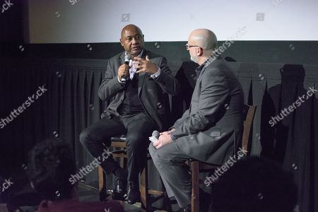 Stock Image of Director Raoul Peck and film critic Joe Neumaier