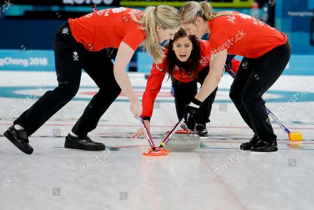 Britain's skip Eve Muirhead, center, watches teammates Vicki Adams, right, and Lauren Gray, left, sweep the ice during the women's bronze medal curling match against Japan at the 2018 Winter Olympics in Gangneung, South Korea