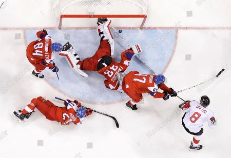 Wojtek Wolski (8), of Canada, scores a goal past goalie Pavel Francouz (33), of the Czech Republic, during the third period of the men's bronze medal hockey game at the 2018 Winter Olympics in Gangneung, South Korea