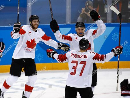 Wojtek Wolski (8), of Canada, celebrates a goal against the Czech Republic with his teammates during the third period of the men's bronze medal hockey game at the 2018 Winter Olympics in Gangneung, South Korea