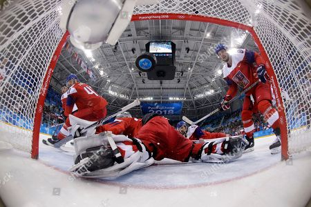 Wojtek Wolski (8), of Canada, shoots a goal past goalie Pavel Francouz (33), of the Czech Republic, during the third period of the men's bronze medal hockey game at the 2018 Winter Olympics in Gangneung, South Korea