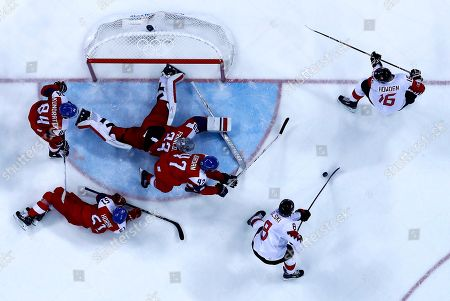 Stock Photo of Wojtek Wolski of Canada (down-R) scores the 6-2  during the Men's Ice Hockey bronze medal game between Czech Republic and Canada at the Gangneung Hockey Centre during the PyeongChang 2018 Winter Olympic Games, in Gangneung, South Korea, 24 February 2018.
