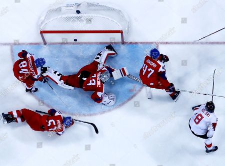 Stock Image of Wojtek Wolski of Canada (down-R) scores the 6-2  during the Men's Ice Hockey bronze medal game between Czech Republic and Canada at the Gangneung Hockey Centre during the PyeongChang 2018 Winter Olympic Games, in Gangneung, South Korea, 24 February 2018.