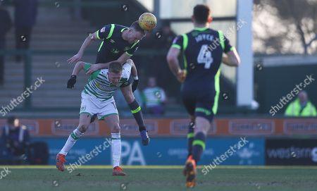 Clint Hill of Carlisle United wins a header