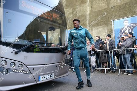 Swansea City striker Tammy Abraham (10) arrives off the coach before the Premier League match between Brighton and Hove Albion and Swansea City at the American Express Community Stadium, Brighton and Hove. Picture by Phil Duncan