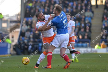 Blackpool Forward, Kyle Vassell (7) and Portsmouth Defender, Matt Clarke (5) come together during the EFL Sky Bet League 1 match between Portsmouth and Blackpool at Fratton Park, Portsmouth. Picture by Adam Rivers