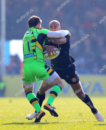 Olly Woodburn of Exeter Chiefs is tackled by Ben Foden of Northampton Saints during the Aviva Premiership match between Exeter Chiefs and Northampton Saints at Sandy Park on February 24th 2018, Exeter, Devon (