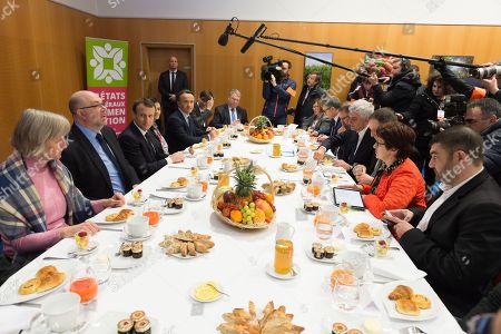 From left to right, a guest, French Agriculture Minister Stephane Travert, Emmanuel Macron, Audrey Bourolleau, Philippe Maugin (INRA), guests, Herve Morin, Christiane Lambert and Jeremie Decerle