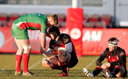 Sam Daly of Plymouth Albion shakes hands with Josh Poole of Birmingham Moseley and Sam Brown of Birmingham Moseley looks dejected after losing during the National Division 1 match between Birmingham Moseley v Plymouth Albion at Billesley Common, Birmingham, Midlands on February 24th 2018, UK.