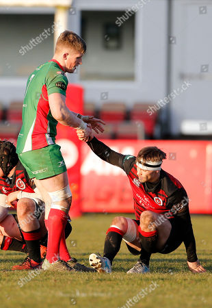 Sam Daly of Plymouth Albion helps dejected Sam Brown of Birmingham Moseley to his feet during the National Division 1 match between Birmingham Moseley v Plymouth Albion at Billesley Common, Birmingham, Midlands on February 24th 2018, UK.
