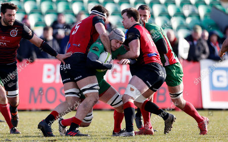 Dan Williams, Captain of Plymouth Albion is tackled by Lewis Bean of Birmingham Moseley during the National Division 1 match between Birmingham Moseley v Plymouth Albion at Billesley Common, Birmingham, Midlands on February 24th 2018, UK.