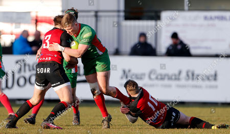 Sam Daly of Plymouth Albion is tackled by Sam Hollingsworth of Birmingham Moseley and Sam Smith of Birmingham Moseley during the National Division 1 match between Birmingham Moseley v Plymouth Albion at Billesley Common, Birmingham, Midlands on February 24th 2018, UK.