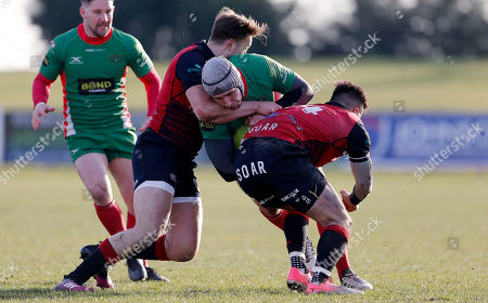 Dan Williams, Captain of Plymouth Albion is tackled by Sam Smith of Birmingham Moseley and Mark Harrison of Birmingham Moseley during the National Division 1 match between Birmingham Moseley v Plymouth Albion at Billesley Common, Birmingham, Midlands on February 24th 2018, UK.