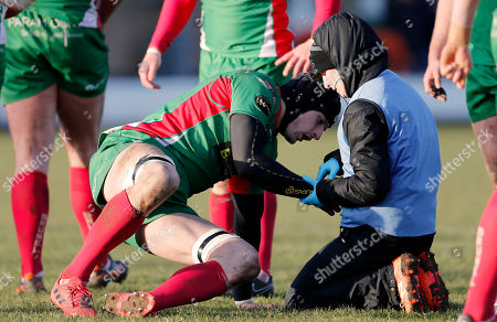 George Mills of Plymouth Albion takes an injury to his arm during the National Division 1 match between Birmingham Moseley v Plymouth Albion at Billesley Common, Birmingham, Midlands on February 24th 2018, UK.