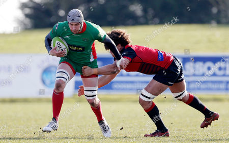 Dan Williams, Captain of Plymouth Albion hands off Buster Lawrence during the National Division 1 match between Birmingham Moseley v Plymouth Albion at Billesley Common, Birmingham, Midlands on February 24th 2018, UK.