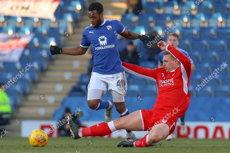 Swindon Town forward Luke Norris challenges Chesterfield midfielder Zavon Hines  during the EFL Sky Bet League 2 match between Chesterfield and Swindon Town at the Proact stadium, Chesterfield. Picture by Aaron  Lupton