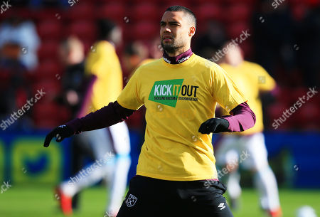 Winston Reid of West Ham United warms up wearing a Kick it out anti racism t shirt