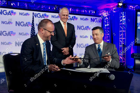 Malcolm Turnbull, Brian Sandoval, Andrew Barr. Australian Chief Minister Andrew Barr, left, accompanied by National Governors Association (NGA) Chair, Gov. Brian Sandoval of Nevada and Australian Prime Minister Malcolm Turnbull, sign a Memorandum of Understanding between the National Governors Association and and Council of the Australian Federation, during the National Governor Association 2018 winter meeting,, in Washington