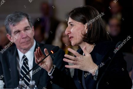 Gladys Berejiklian, Roy Cooper. Australian NSW Premier Gladys Berejiklian speaks accompanied during the National Governor Association 2018 winter meeting,, in Washington. Gov. Roy Cooper of North Carolina looks on