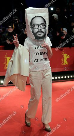 Stock Image of German actress Franziska Petri wears a paper bag with a photo of detained Russian director Kirill Serebrennikov on the red carpet for the awarding ceremony of the 68th edition of the International Film Festival Berlin, Berlinale, in Berlin, Germany