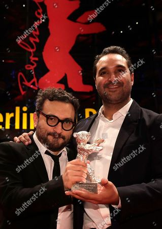 Manuel Alcala, left, and Alonso Ruizpalacios show their silver bear for the best screen play for the film 'Museo / Museum' after the awarding ceremony of the 68th edition of the International Film Festival Berlin, Berlinale, in Berlin, Germany