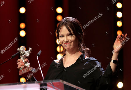 Actress Elena Lyadova holds her silver bear for outstanding artistic contribution in the film 'Dovlatov' during the awarding ceremony of the 68th edition of the International Film Festival Berlin, Berlinale, in Berlin, Germany