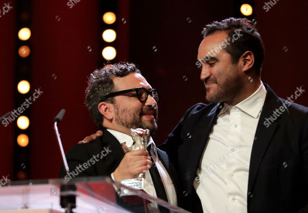 Manuel Alcala, left, and Alonso Ruizpalacios celebrate after winning a silver bear for the best screen play for the film 'Museo / Museum' during the awarding ceremony of the 68th edition of the International Film Festival Berlin, Berlinale, in Berlin, Germany