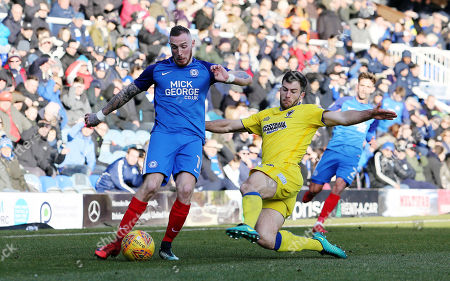Marcus Maddison of Peterborough United in action with Jonathan Meades of AFC Wimbledon