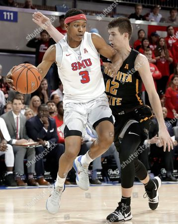 Austin Reaves, William Douglas. Southern Methodist guard William Douglas (3) works against Wichita State guard Austin Reaves (12) for a shot attempt in the second half of an NCAA college basketball game, in Dallas