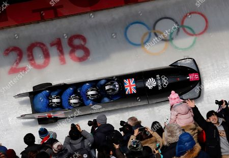 Driver Brad Hall, Greg Cackett, Nick Gleeson and Joel Fearon of Britain take turn 14 during in their third heat during the four-man bobsled competition final at the 2018 Winter Olympics in Pyeongchang, South Korea