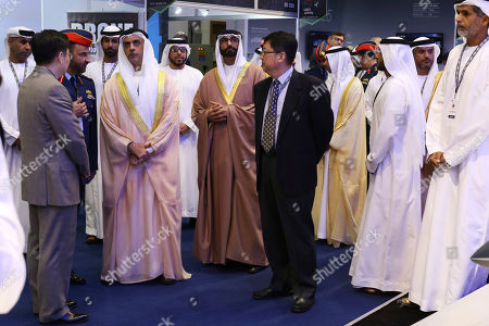 Emirati Interior Minister Sheikh Saif bin Zayed Al Nahyan, left, and Emirati Minister of State for Defense Mohammed bin Ahmed al-Bowardi speak to Chinese officials at a drone conference in Abu Dhabi, United Arab Emirates, . The United Arab Emirates on Sunday opened a stand-alone trade show featuring military drones called the Unmanned Systems Exhibition & Conference, showing the power the weapons have across the Middle East