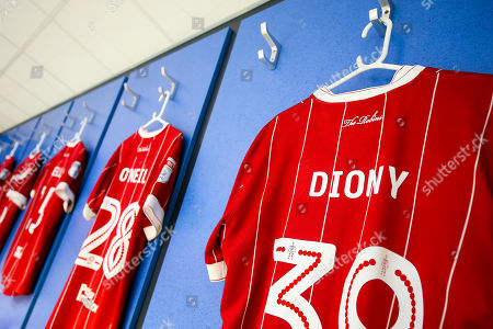 Shirts of Lois Diony and Gary O'Neil of Bristol City hanging in the away dressing room