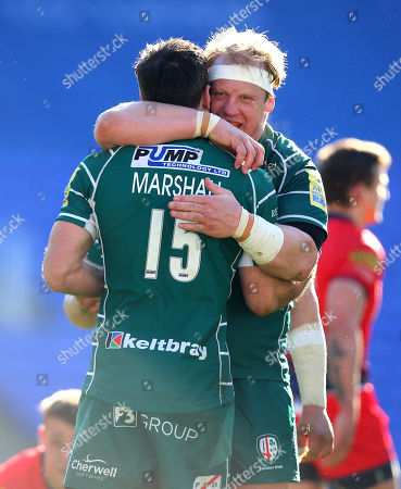 Petrus Du Plessis of London Irish hugs James Marshall of London Irish after their side's win over Worcester Warriors