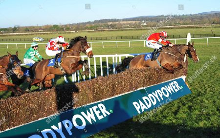 Naas DINNIE'S VINNIE & Luke Dempsey (right) Jump the last to win the Jordans Centra Handicap Steeplechase from GOULANE DAVINA & Barry John Foley (left).