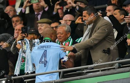 Manchester City's Vincent Kompany shakes hands with Chairman Khaldoon Al Mubarak