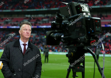 Ex Manchester United Manager Louis van Gaal is seen pitchside.
