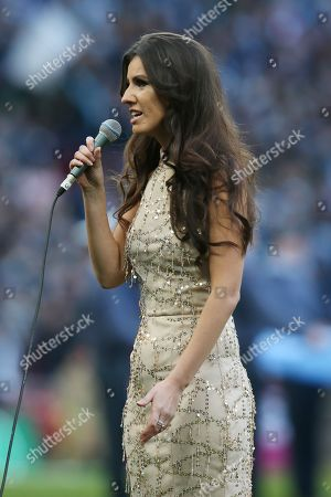Singer Faryl Smith before the start of the match
