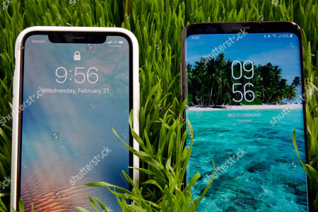 IPhone X, Samsung S9 Plus. This, photo shows an Apple iPhone X, left, and a Samsung Galaxy S9 Plus mobile phone during a preview in New York. The Galaxy S9 phones were unveiled Sunday, Feb. 25, in Barcelona, Spain, and will be available March 16. Advance orders begin this Friday