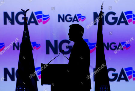 Nana Akufo-Addo, Brian Sandoval. National Governors Association Chair, Nevada Gov. Brian Sandoval watches a video clip before the introduction of Ghana's President Nana Akufo-Addo at the National Governor Association winter meeting, in Washington