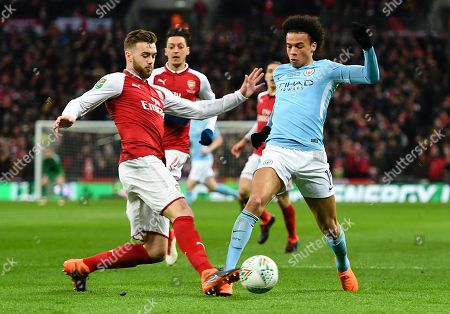 Manchester City's Leroy Sane is tackled by Arsenal's Calum Chambers