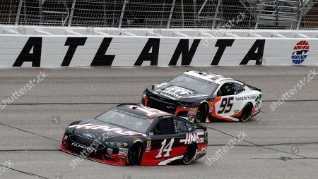 Monster Energy NASCAR Cup Series drivers Clint Bowyer (14) and Kasey Kahne (95) battle through turn four during the NASCAR Cup Series auto race at Atlanta Motor Speedway in Hampton, Ga., on