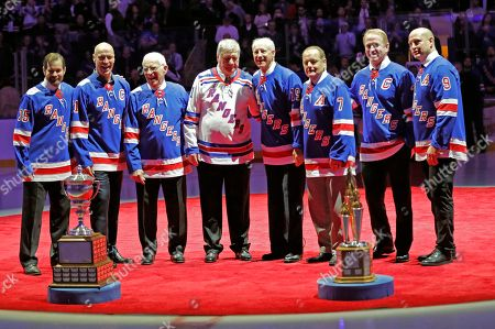 Mark Richter, Mark Messier, Eddie Giacomin, Vic Hadfield, Jean Ratelle, Rod Gilbert, Brian Leetch, Adam Graves. New York Rangers Hall of Famer Jean Ratelle, fourth from right, stands with former Rangers at a ceremony retiring Ratelle's No. 19 before an NHL hockey game between the Rangers and the Detroit Red Wings at Madison Square Garden in New York