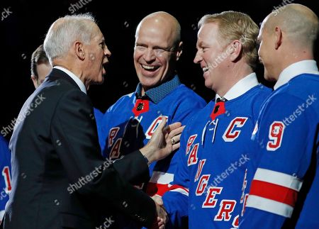 Jean Ratelle, Mark Messier, Brian Leetch, Adam Graves. New York Rangers Hall of Famer Jean Ratelle, left, chats with former Rangers whose retired jersey numbers already hang from the ceiling at Madison Square Garden during a ceremony retiring Ratelle's number before an NHL hockey game between the New York Rangers and Detroit Red Wings in New York, . Shown with Ratelle are from left, Mark Messier, Brian Leetch, and Adam Graves (9). Ratelle, who played parts of 16 of his 21 NHL seasons with the Rangers, entered the Hockey Hall of Fame in 1985 and is second on the Rangers' goals list with 336 and third in assists with 481 and points with 817