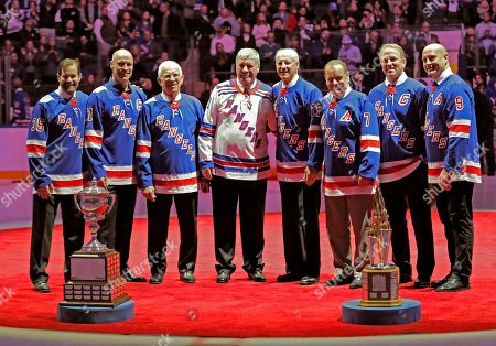 Mark Richter, Mark Messier, Eddie Giacomin, Vic Hadfield, Jean Ratelle, Rod Gilbert, Brian Leetch, Adam Graves. New York Rangers whose numbers have already been retired pose for photographs with Hall of Famer Jean Ratelle, fourth from right, at a ceremony retiring Ratelle's number 19 before an NHL hockey game between the New York Rangers and Detroit Red Wings at Madison Square Garden in New York, . Ratelle, who played parts of 16 of his 21 NHL seasons with the Rangers, entered the Hockey Hall of Fame in 1985 and is second on the Rangers' goals list with 336 and third in assists with 481 and points with 817. From left are Mark Richter, Mark Messier, Eddie Giacomin, Vic Hadfield, who will have his number retired, Ratelle, Rod Gilbert, Brian Leetch and Adam Graves