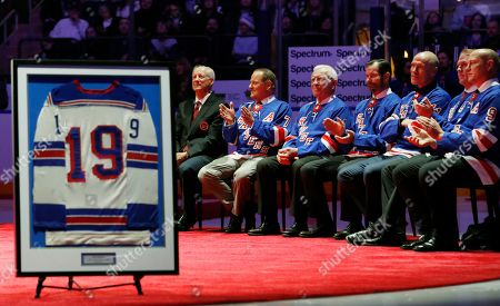 Jean Ratelle, Rod Gilbert, Eddie Giacomin, Mark Richter, Mark Messier, Brian Leetch, Adam Graves. New York Rangers Hall of Famer Jean Ratelle sits beside former Rangers whose numbers have been retired at a ceremony retiring Ratelle's number 19 before an NHL hockey game between the New York Rangers and Detroit Red Wings at Madison Square Garden in New York, . Ratelle, who played parts of 16 of his 21 NHL seasons with the Rangers, entered the Hockey Hall of Fame in 1985 and is second on the Rangers' goals list with 336 and third in assists with 481 and points with 817. From left are Ratelle, Rod Gilbert, Eddie Giacomin, Mark Richter, Mark Messier, Brian Leetch and Adam Graves