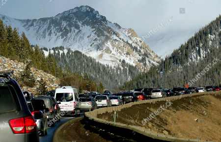 Traffic backs up on Interstate 70 in Colorado, a familiar scene on the main highway connecting Denver to the mountains The chairman of a committee exploring whether Denver should bid on the 2030 Olympics says buses or giving incentives to truckers to avoid the highway could help keep traffic moving if the city hosted the games. Rob Cohen also says a possible surplus could help pay to improve the highway later