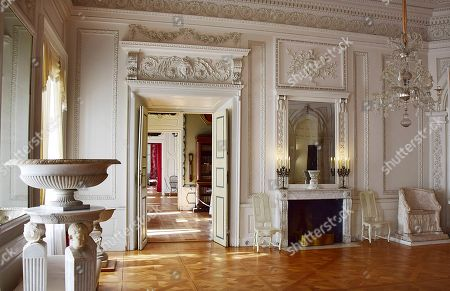 The photo shows the White Room, which also served as the ballroom, of the early classicist Nieborow Palace in central Poland. Lee Radziwill, sister-in-law of John F. Kennedy, was married to the son of Prince Janusz Radziwill, the palace's last owner before it was seized