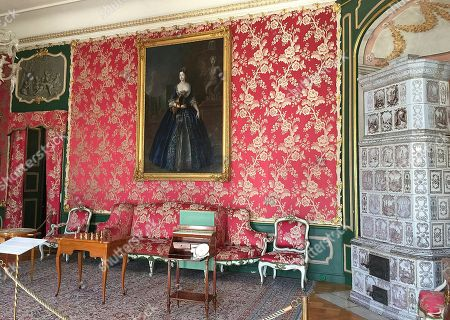 The photo shows the Red Drawing Room of the early classicist Nieborow Palace in central Poland. Lee Radziwill, sister-in-law of John F. Kennedy, was married to the son of Prince Janusz Radziwill, the palace's last owner before it was seized