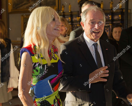"Designer Donatella Versace, left, and Stephen A. Schwarzman, CEO of Blackstone, attend an event at Palazzo Colonna in Rome, . The Vatican culture minister, Cardinal Gianfranco Ravasi, joined Vogue Editor-in-Chief Anna Wintour and designer Donatella Versace in Rome on Monday to display a few of the Vatican treasures at the Palazzo Colonna, a onetime papal residence. ""Heavenly Bodies: Fashion and the Catholic Imagination"" is set to open May 10 at the Met's Costume Institute in New York"