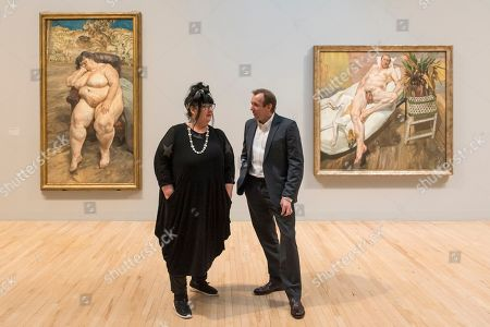 Sue Tilley and David Dawson stand with paintings of themselves by Lucian Freud (L to R) 'Sleeping by the Lion Carpet', 1996, and 'David and Eli', 2003-4.